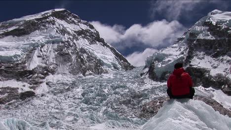 Climber-sitting-looking-out-at-Khumbu-icefall