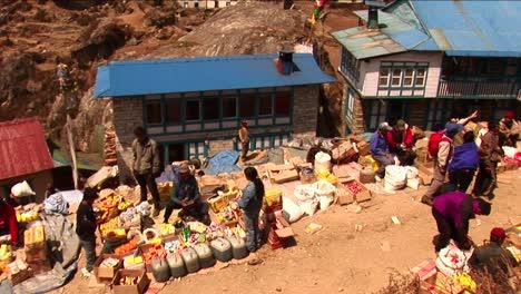 Man-selling-goods-in-medium-shot-of-Namche-Market
