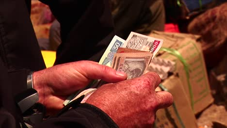 Counting-money-to-give-to-vendor-in-a-Himalayan-market