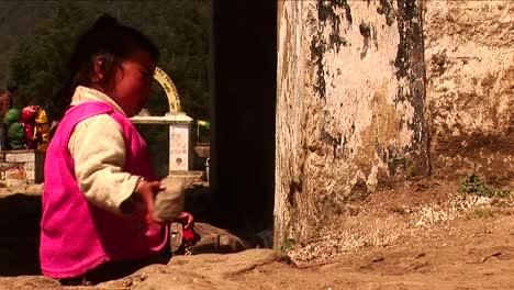 Little-nepalese-girl-playing-with-stone-in-Kathmandu-Nepal