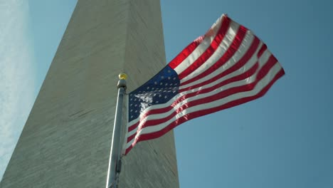 The-American-flag-flies-with-the-Washington-Monument-in-the-background-in-this-patriotic-Washington-DC-shot