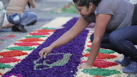 Locals-decorate-an-alfombra-or-carpet-during-Semana-Santa-Easter-week-in-Antigua-Guatemala-7
