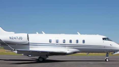 A-jet-taxis-in-front-of-a-private-jet-on-a-parking-pad-at-an-airfield-in-Deer-Lodge-Montana