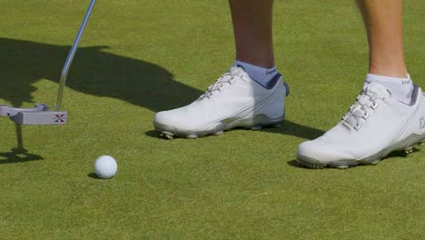 Close-up-shot-of-a-golfer-practicing-his-putting-putting-technique-on-a-golf-green