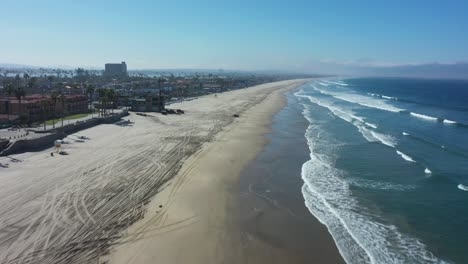 Aerial-of-empty-abandoned-beaches-of-southern-california-with-no-one-during-covid19-coronavirus-epidemic-as-people-stay-home-en-masse