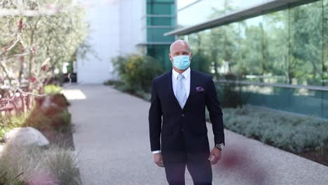 A-model-released-man-demonstrates-the-proper-way-to-put-on-a-protective-mask-during-the-Covid19-coronavirus-epidemic-outbreak