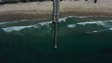 Aerial-of-empty-abandoned-pier-in-southern-california-with-no-one-during-covid19-coronavirus-epidemic-as-people-stay-home-en-masse