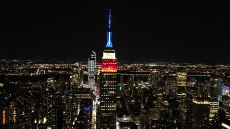 Good-aerial-of-the-spire-of-the-Empire-State-Building-lit-up-red-white-and-blue-in-New-York-City-New-York