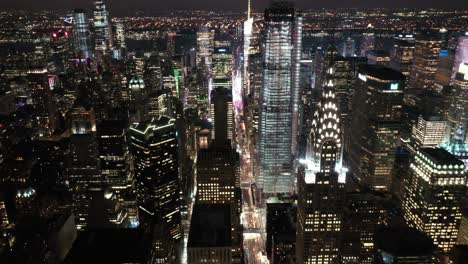 An-aerial-view-shows-the-skyline-of-42nd-Street-in-New-York-City-New-York-at-night-highlighting-the-Chrysler-Building