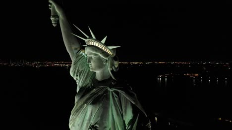 An-excellent-orbiting-aerial-view-shows-the-upper-half-of-the-Statue-of-Liberty-in-New-York-City-New-York-at-night