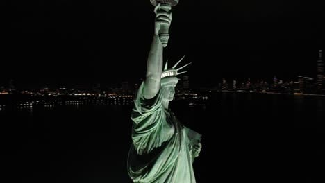 An-excellent-orbiting-aerial-view-shows-the-upper-half-of-the-Statue-of-Liberty-in-New-York-City-New-York-at-night-1