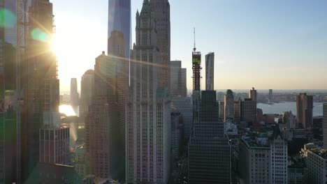 An-aerial-view-shows-an-approach-to-the-Woolworth-Building-at-sunset-in-New-York-City-New-York