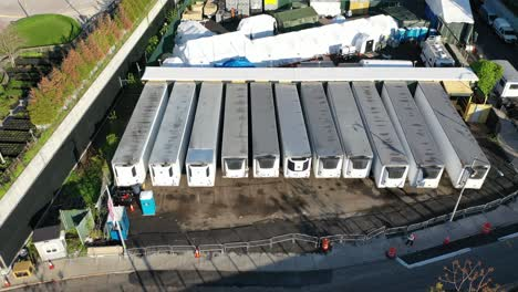 An-aerial-view-over-temporary-morgue-refrigeration-trailers-containing-the-bodies-of-victims-of-the-coronavirus-pandemic-1