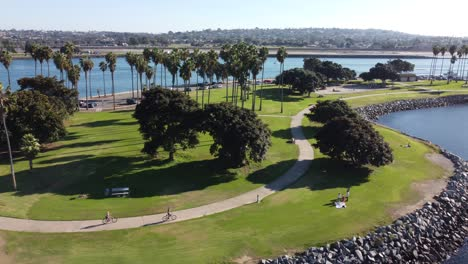 Aerial-of-people-riding-bicycles-at-Mission-Point-Park-San-Diego-California