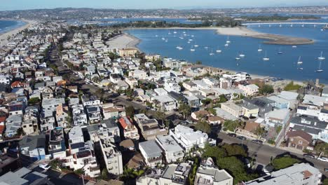 Nice-aerial-over-seaside-condos-and-vacation-homes-along-South-Mission-Beach-San-Diego-California-1