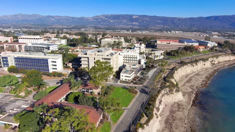Aerial-of-the-University-of-California-Santa-Barbara-UCSB-college-campus-with-Storke-Tower-distant-and-research-buildings-1