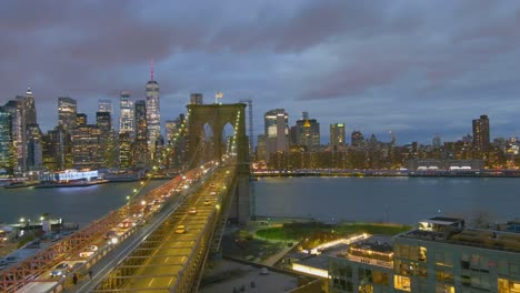 Magnificent-beautiful-dramatic-aerial-of-the-Brooklyn-Bridge-at-night-in-New-York-City