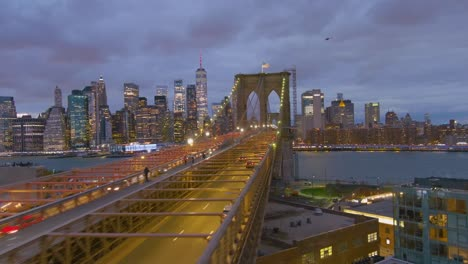 Magnificent-beautiful-dramatic-aerial-of-the-Brooklyn-Bridge-at-night-in-New-York-City-1