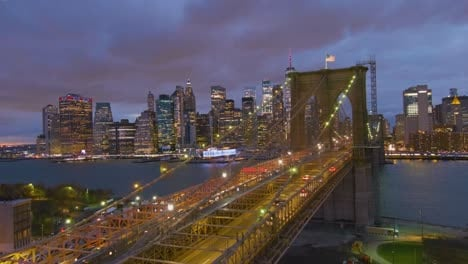 Magnificent-beautiful-dramatic-aerial-of-the-Brooklyn-Bridge-at-night-in-New-York-City-2