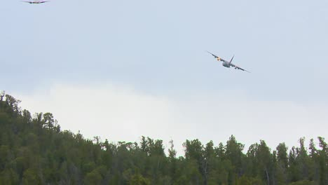 A-C130-Makes-Practice-Water-Drops-Over-A-Forest-In-Colorado-1