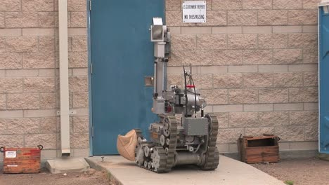 A-Bomb-Disposal-Squad-Uses-A-Remote-Control-Robot-To-Defuse-A-Hidden-Explosive