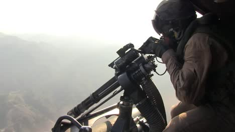 Marines-Fire-On-The-Enemy-From-A-Helicopter-Using-Machine-Guns-1