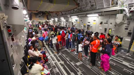 Philippine-Refugees-Are-Led-Onto-A-Us-Cargo-Plane-During-Typhoon-Haiyan