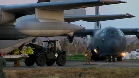 Emergency-Relief-Supplies-Are-Delivered-From-A-Kc130-Super-Hercules-Aircraft-To-Victims-Of-Typhoon-Haiyan-In-The-Philippines