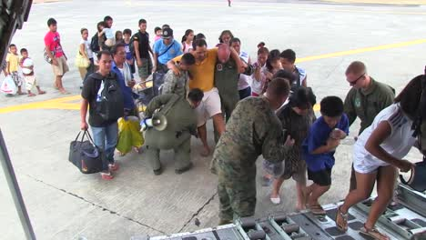 Injured-Philippine-Refugees-Are-Led-Onto-A-Us-Cargo-Plane-During-Typhoon-Haiyan