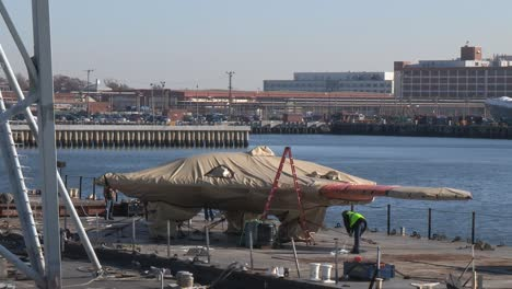 A-Secret-Us-Spy-Plane-The-X47B-Unmanned-Combat-Air-System-Is-Loaded-Onto-An-Aircraft-Carrier