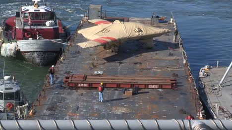 A-Secret-Us-Spy-Plane-The-X47B-Unmanned-Combat-Air-System-Is-Delivered-To-A-Base-On-A-Floating-Barge