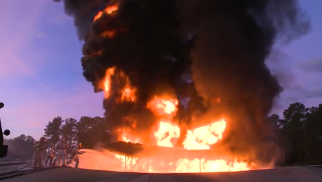 Firefighters-Battle-A-Raging-Chemical-Fire-In-A-Simulated-Airplane-Crash