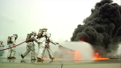 Firefighters-Battle-A-Raging-Chemical-Fire-In-A-Simulated-Airplane-Crash-13