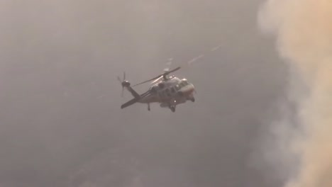 Helicopters-Make-Water-Drops-On-A-Brush-Fire