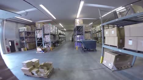 High-Speed-Pov-Shot-Traveling-Through-A-Large-Warehouse-Facility