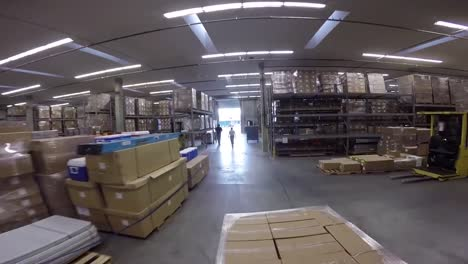 High-Speed-Pov-Shot-Traveling-Through-A-Large-Warehouse-Facility-1