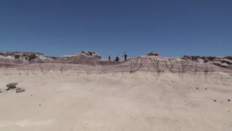 Hikers-Explore-Petrified-Forest-National-Park-In-Arizona-1