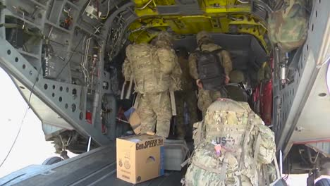 Marines-Load-A-Ch47-Chinook-Helicopter-In-Afghanistan