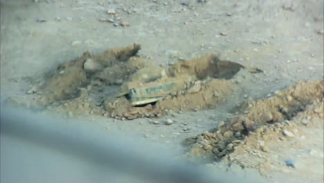 A-Patrol-In-Afghanistan-Encounters-An-Ied-Along-The-Road-And-Attempts-To-Diffuse-It