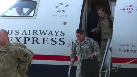 Us-Servicemen-And-Women-Are-Welcomed-Home-In-An-Airport-After-A-Recent-Deployment-To-Afghanistan-1