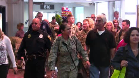 Us-Servicemen-And-Women-Are-Welcomed-Home-In-An-Airport-After-A-Recent-Deployment-To-Afghanistan-2