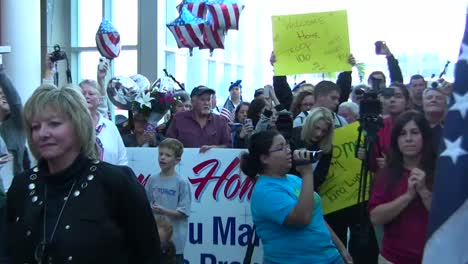 Us-Servicemen-And-Women-Are-Welcomed-Home-In-An-Airport-After-A-Recent-Deployment-To-Afghanistan-3