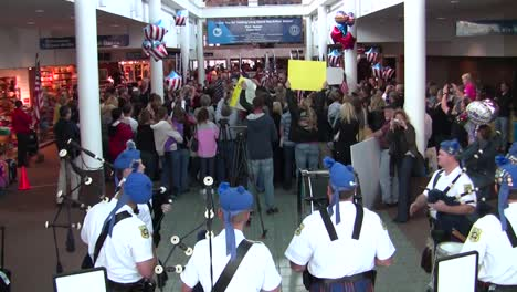Us-Servicemen-And-Women-Are-Welcomed-Home-In-An-Airport-After-A-Recent-Deployment-To-Afghanistan-4
