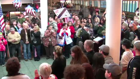 Us-Servicemen-And-Women-Are-Welcomed-Home-In-An-Airport-After-A-Recent-Deployment-To-Afghanistan-5