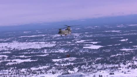 A-Military-Helicopter-Delivers-An-Airlift-Into-A-Remote-Section-Of-Alaska