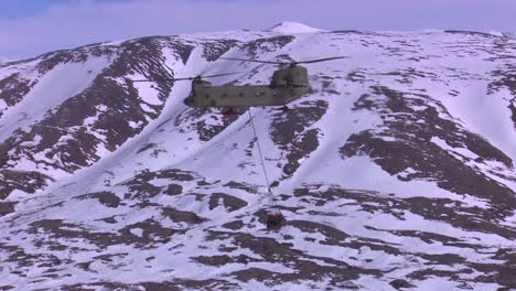 A-Military-Helicopter-Delivers-An-Airlift-Into-A-Remote-Section-Of-Alaska-1