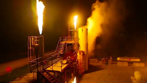 Firefighters-Battle-A-Simulated-Industrial-Fire-At-Night