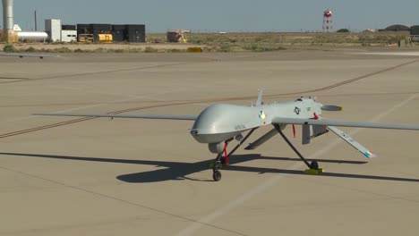 Multiple-Shots-Of-Us-Drone-Surveillance-Aircraft-Parked-On-A-Runway-3