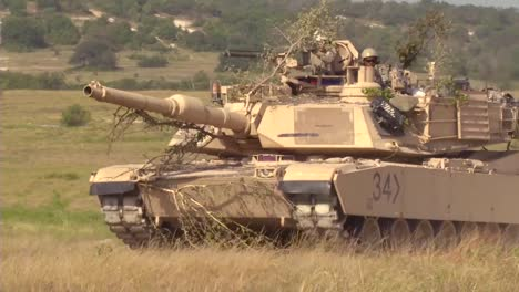Camouflaged-Tanks-Advance-On-The-Battlefield