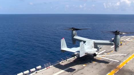 Various-Shots-Of-The-Osprey-Helicopter-Taking-Off-From-The-Deck-Of-An-Aircraft-Carrier